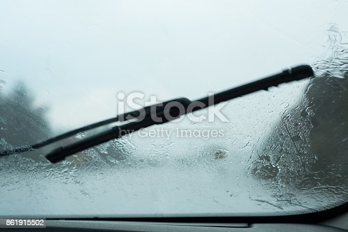 1054750504 istock photo Highway Driver POV Through Raindrop Car Windshield During Rain Storm 861915502