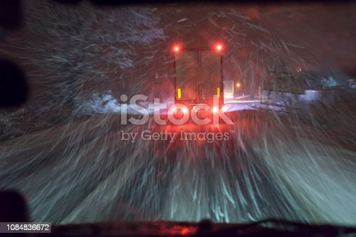657042754 istock photo highway, driving at night during the blizzard 1084836672