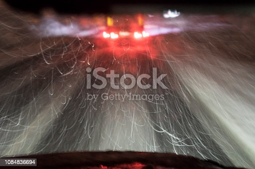 657042754 istock photo highway, driving at night during the blizzard 1084836694