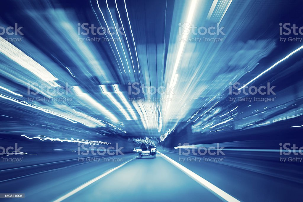 Highway driving at night with long exposure light trails stock photo