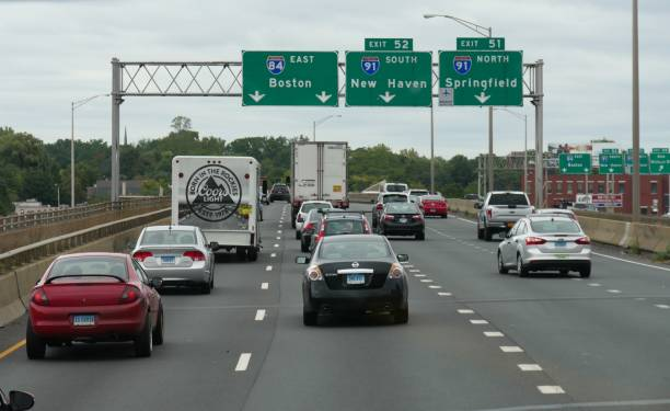 highway for directions and arrows to Boston stock photo