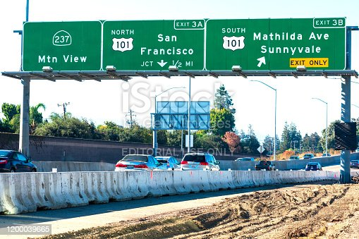 144334852 istock photo Highway improvement project in progress. Barrier for worker, pedestrian, and traffic safety. Car traffic under interstate 237 and 101 highway road sign 1200039665
