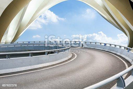 637668332 istock photo highway in front of modern bridge construction 637632376
