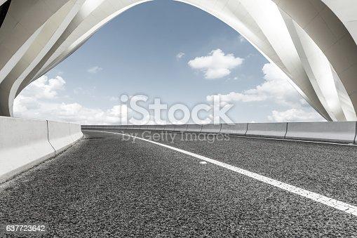 637668332 istock photo highway in front of modern bridge construction 637723642