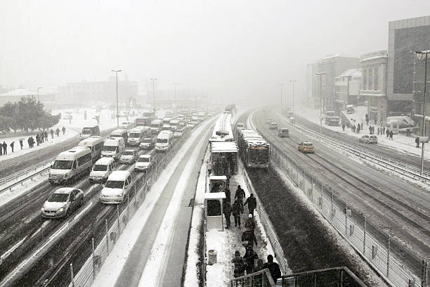 "highway in winter ""Istanbul,Turkey - February 1, 2012:  Busy traffic scene in Europan side of Istanbul from florya district.Traffic jam in the city of Istanbul in winter."" middle of the road stock pictures, royalty-free photos & images"