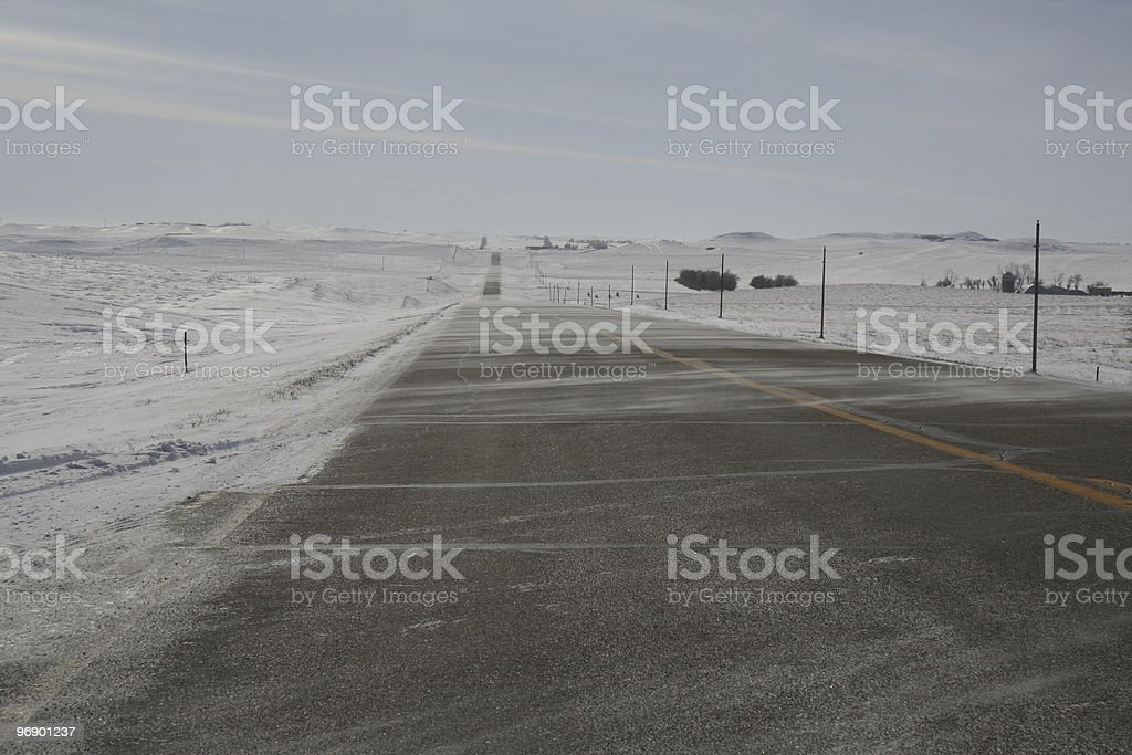 Highway in Winter with Ground Drifting royalty-free stock photo