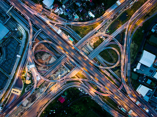 Highway junction from aerial view Highway junction in  Bangna, the east of Bangkok from aerial view in the night. Taken in August 2016. multiple lane highway stock pictures, royalty-free photos & images