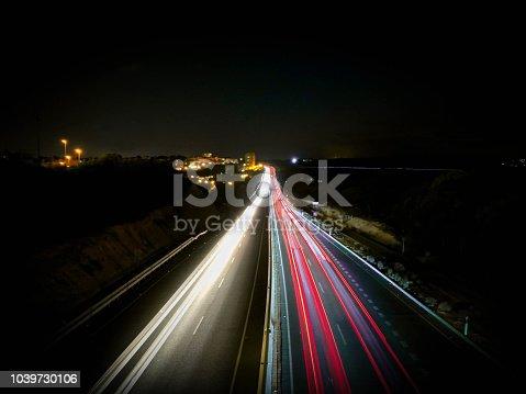 539234032 istock photo Highway lights at night 1039730106