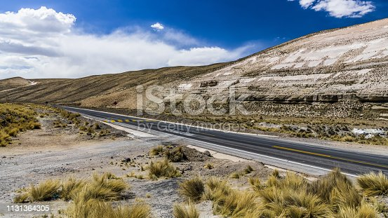 The highway runs on a wide plateau in the Central part of the Andes in Peru.