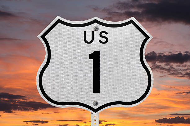 US Highway One Sign with Sunrise Sky stock photo