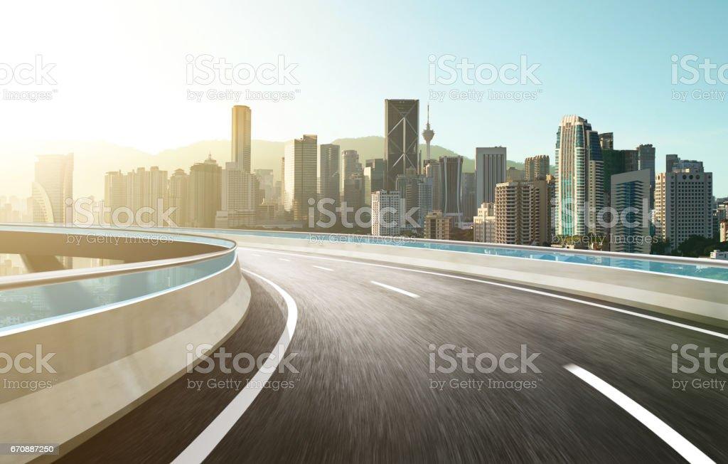 Highway overpass modern city skyline background . Sunrise scene . stock photo