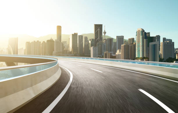 Highway overpass modern city skyline background . Sunrise scene . stock photo