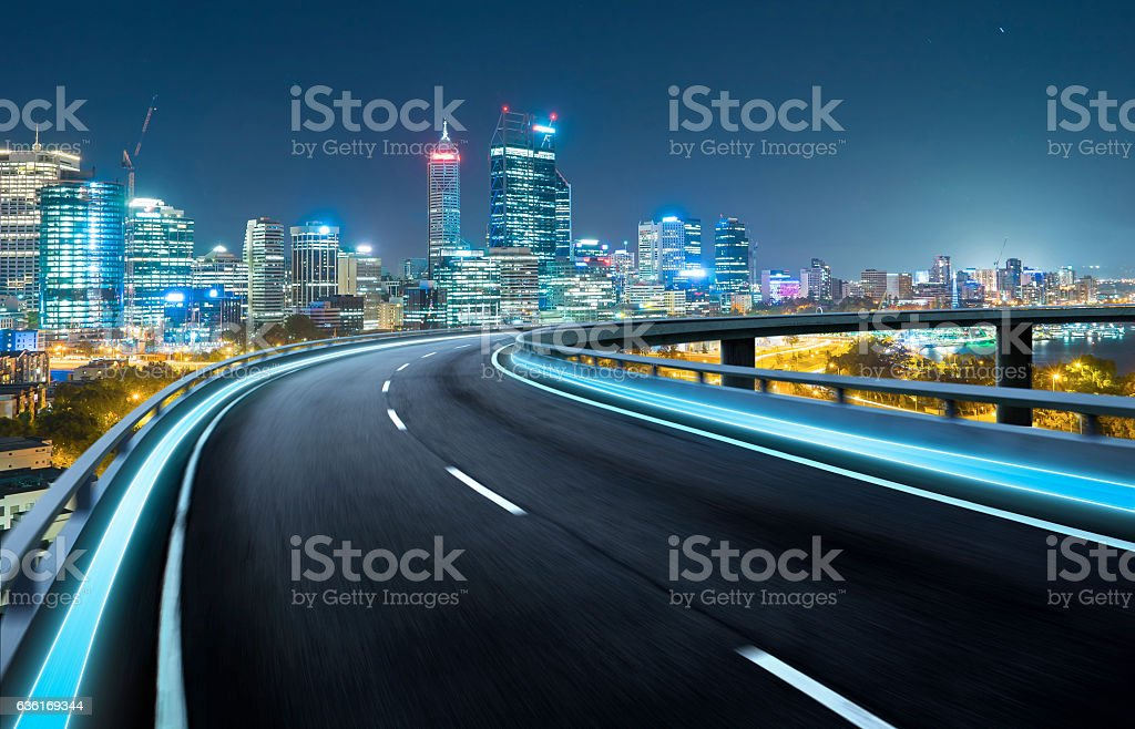 Highway overpass motion blur with city background . stock photo