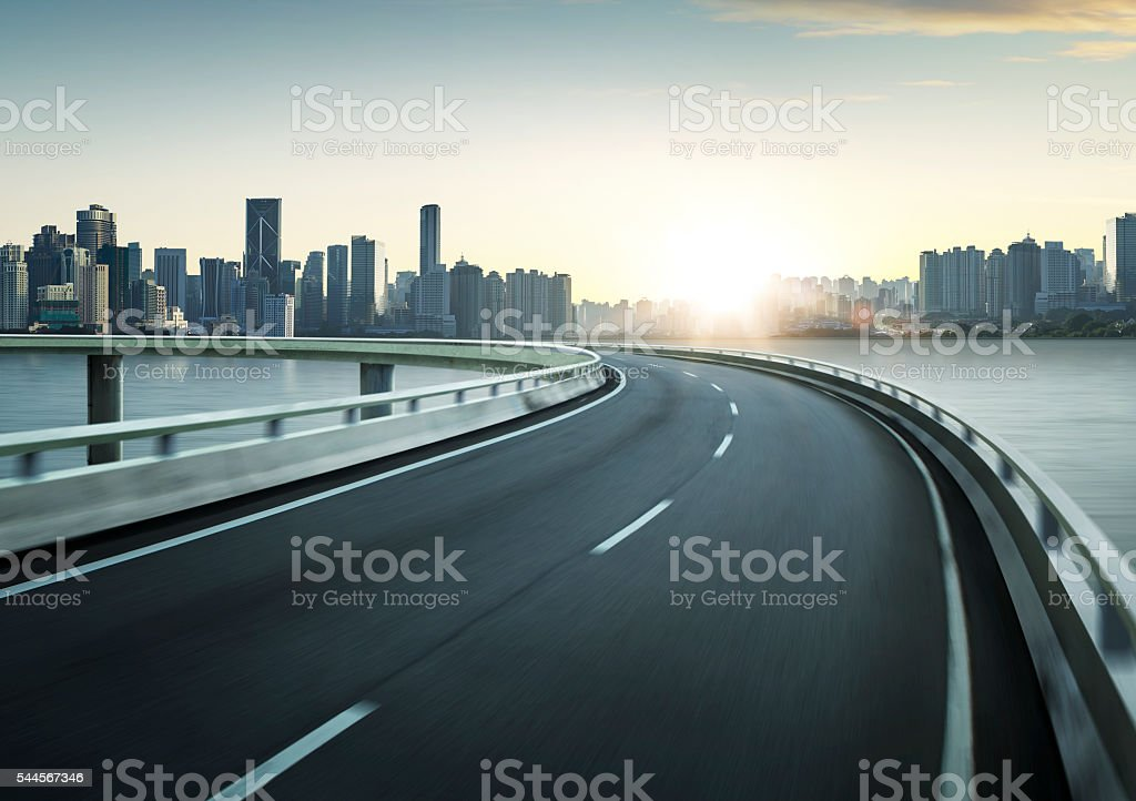 Highway overpass motion blur with city skyline background . stock photo