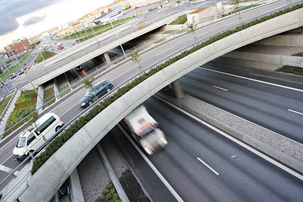 Highway overpass with few vehicles stock photo