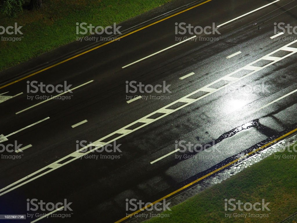 Highway road at night in the rain in the light of street lamps. Top...