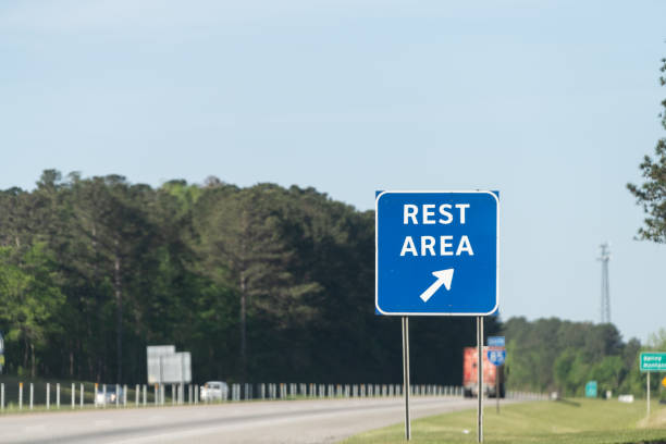 Highway road in Alabama with welcome center rest area sign on street with nobody at visitor center in Lanett, Alabama stock photo