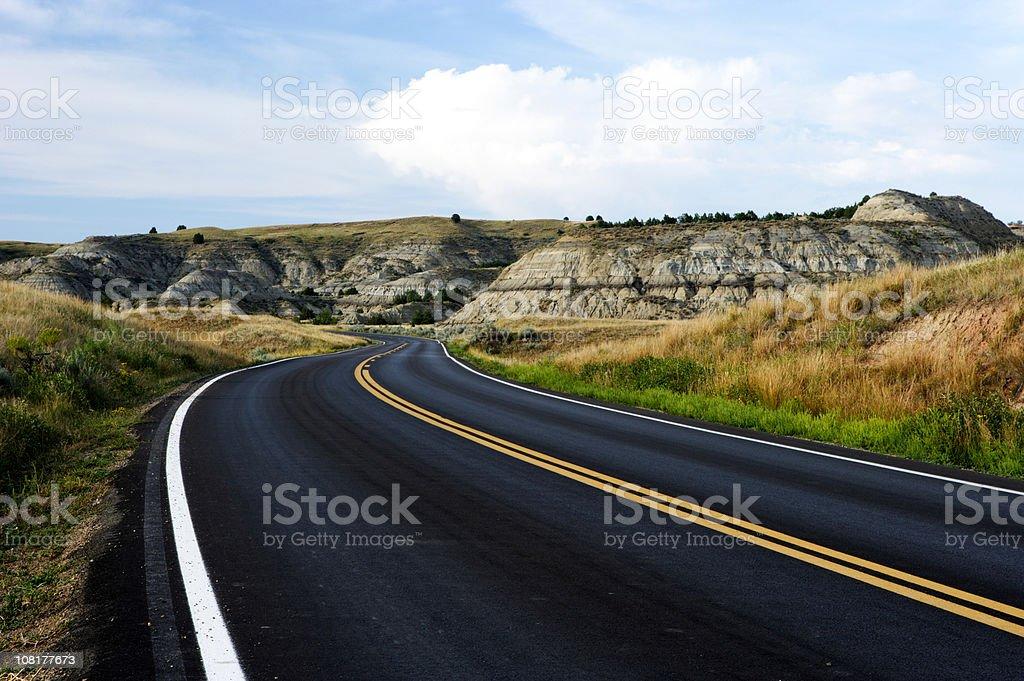 Highway Road Through Badlands stock photo