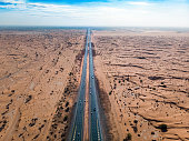 Highway road through the desert aerial view. Arid climate transportation abstract
