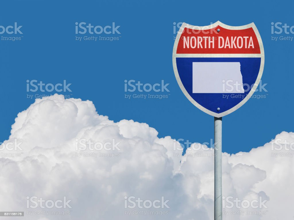 Highway sign for Interstate road in North Dakota with map in front of clouds stock photo
