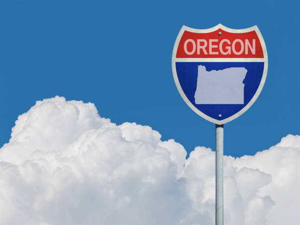 Highway sign for Interstate road in Oregon with map in front of clouds Highway sign for Interstate road in Oregon with map in front of clouds oregon us state stock pictures, royalty-free photos & images