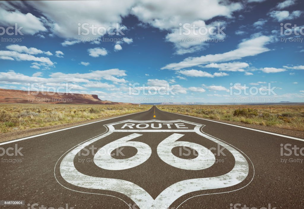 Highway sign for Route 66 on asphalt of country road stock photo