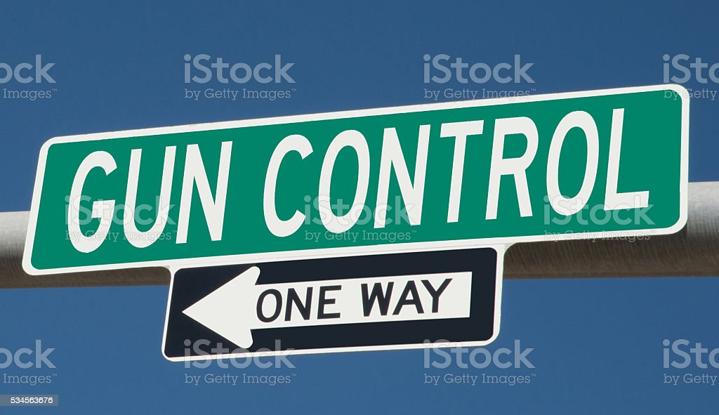 Highway sign with 'gun control' and 'one way' stock photo