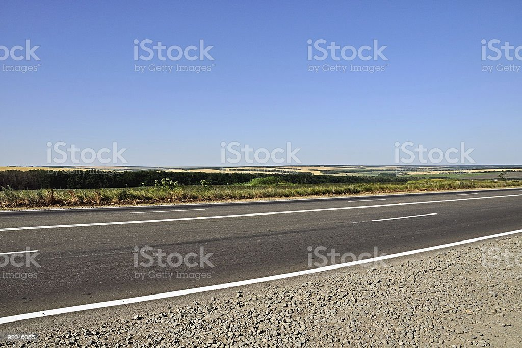 Highway, sky and fields royalty-free stock photo