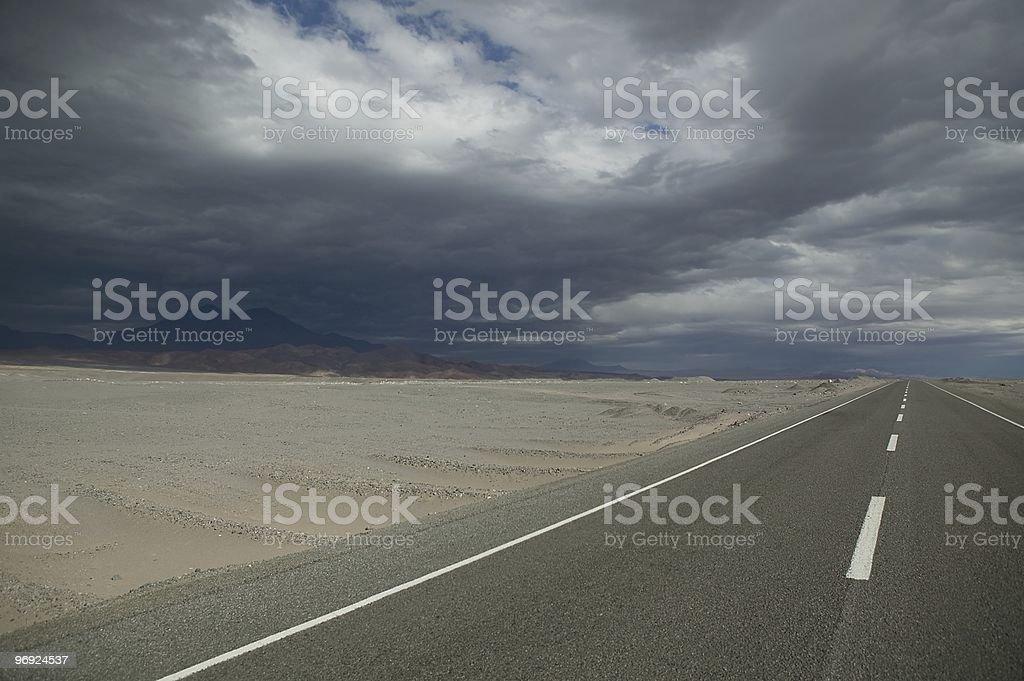 Highway through a desert royalty-free stock photo