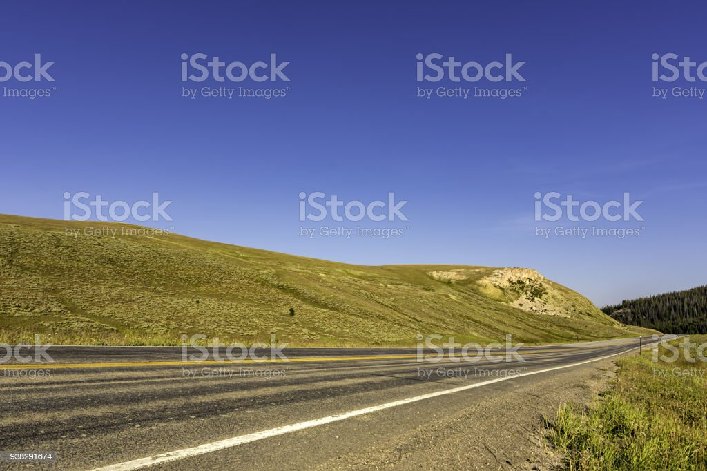Highway through Alpine Meadow Bighorn National Forest Wyoming USA stock photo