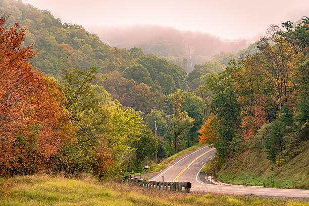 Highway through Fall Foliage stock photo
