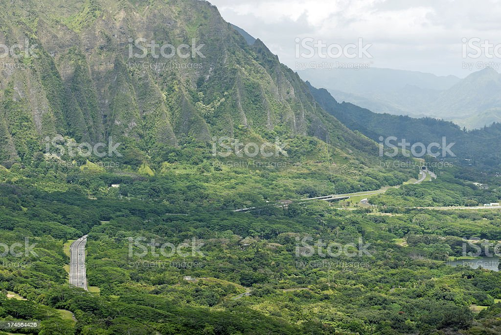 Highway through mountains from Pali Lookout on Oahu HI royalty-free stock photo