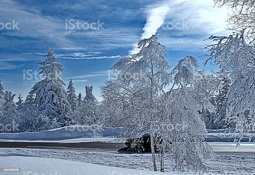 Highway through the middle of the snowy winter forest stock photo