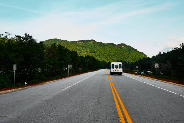 highway through the white mountains in new hampshire with a camper van - loudon stock photos and pictures