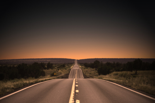 Sunset highway in Northern Arizona. Vignetting and desaturated.