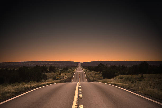 highway to the sunset - ufuk stok fotoğraflar ve resimler