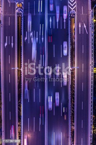 820883024istockphoto highway traffic at night 1157361923
