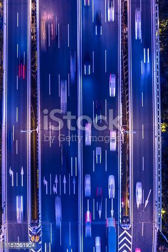 820883024istockphoto highway traffic at night 1157361924