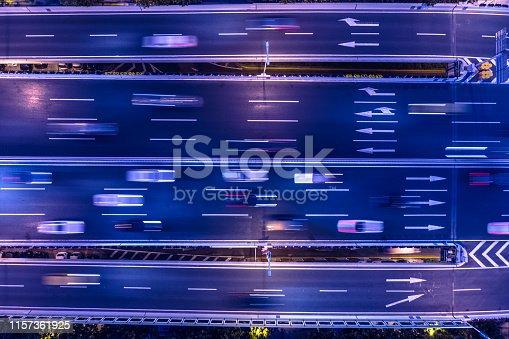 820883024istockphoto highway traffic at night 1157361925