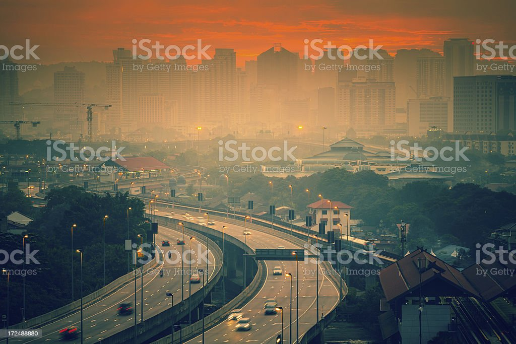 Highway Traffic at Sunset in Big City royalty-free stock photo