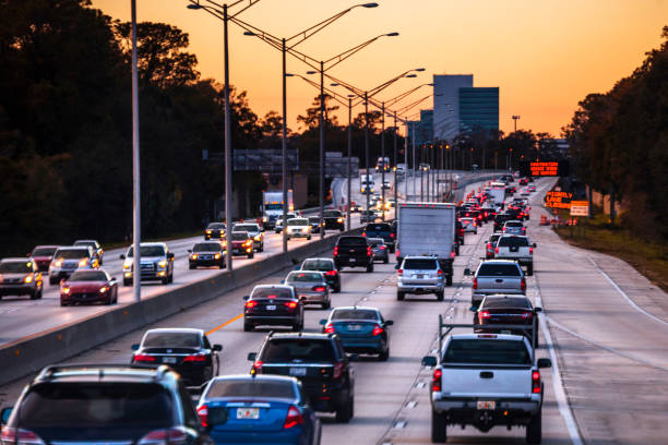 Highway traffic - Jacksonville, Florida Highway traffic to Jacksonville, Florida, US multiple lane highway stock pictures, royalty-free photos & images