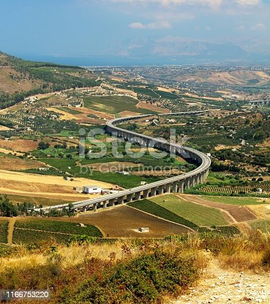 evocative image of highway viaduct in the countryside of Sicily