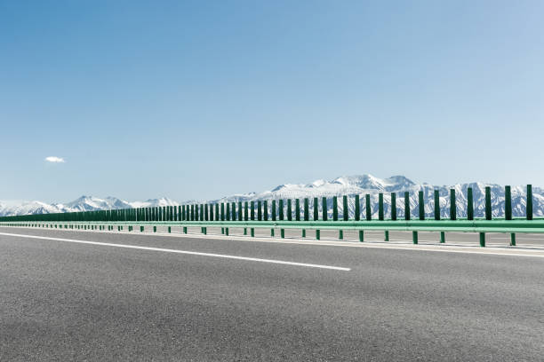 highway with snow mountain stock photo