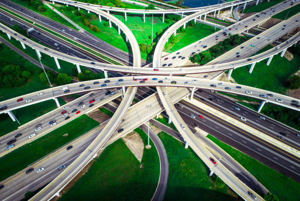 Highways overpass transportation huge interchange Highways overpass transportation aerial drone view above interchange cross overs in Austin Texas elevated road stock pictures, royalty-free photos & images