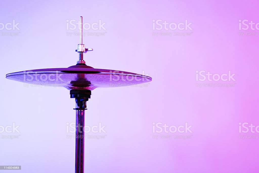 Hi-hat cymbals in pink and blue light royalty-free stock photo