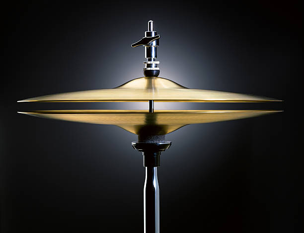 Hi-hat Hi-hat cymbals on dark background (XXXL size) cymbal stock pictures, royalty-free photos & images