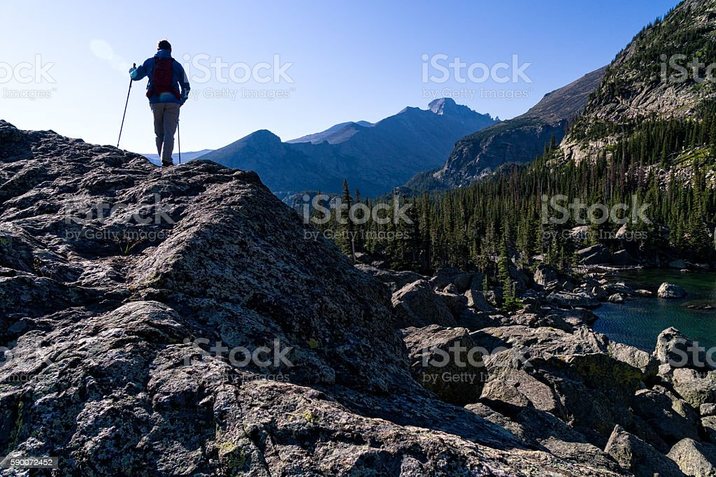 Hiker Abover High Alpine Lake stock photo