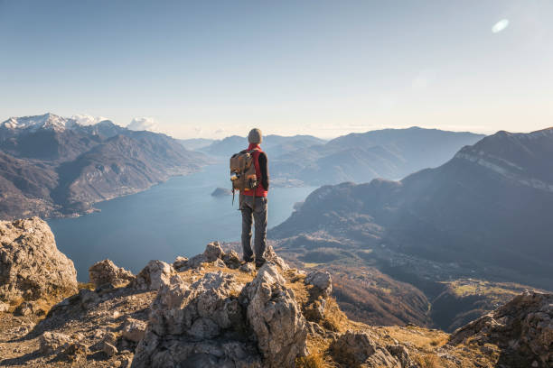 Hiker alone on top of the mountain stock photo