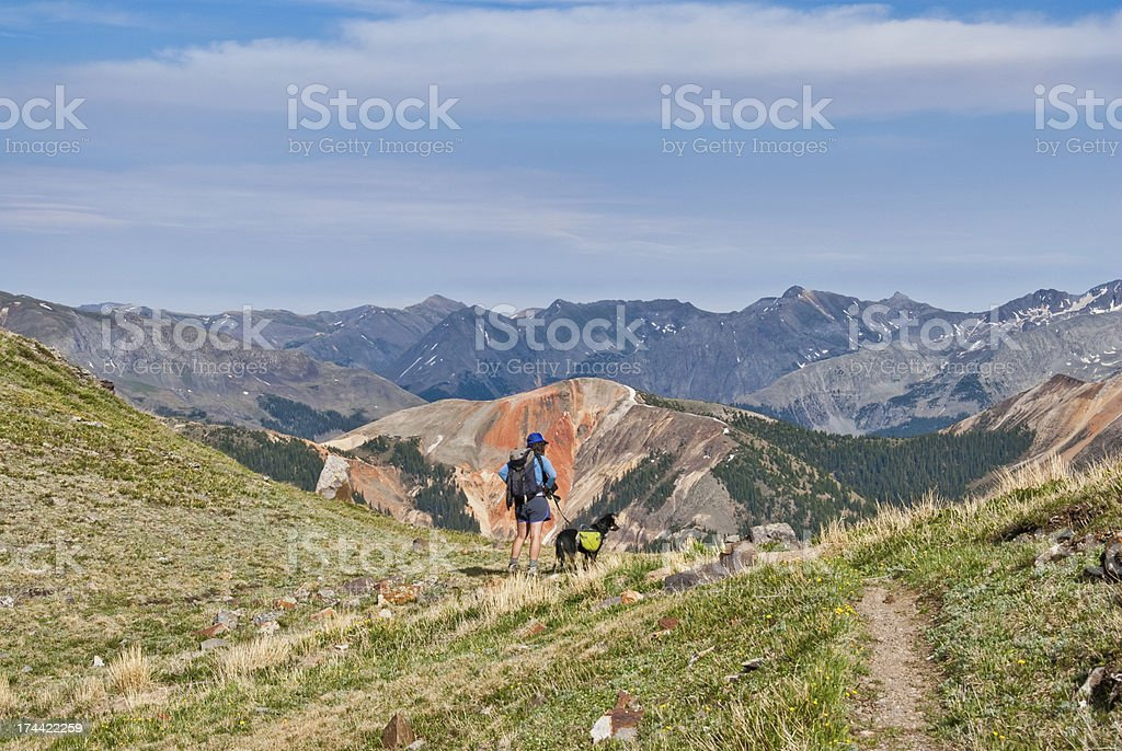 Hiker and Dog Looking at Red Mountain royalty-free stock photo