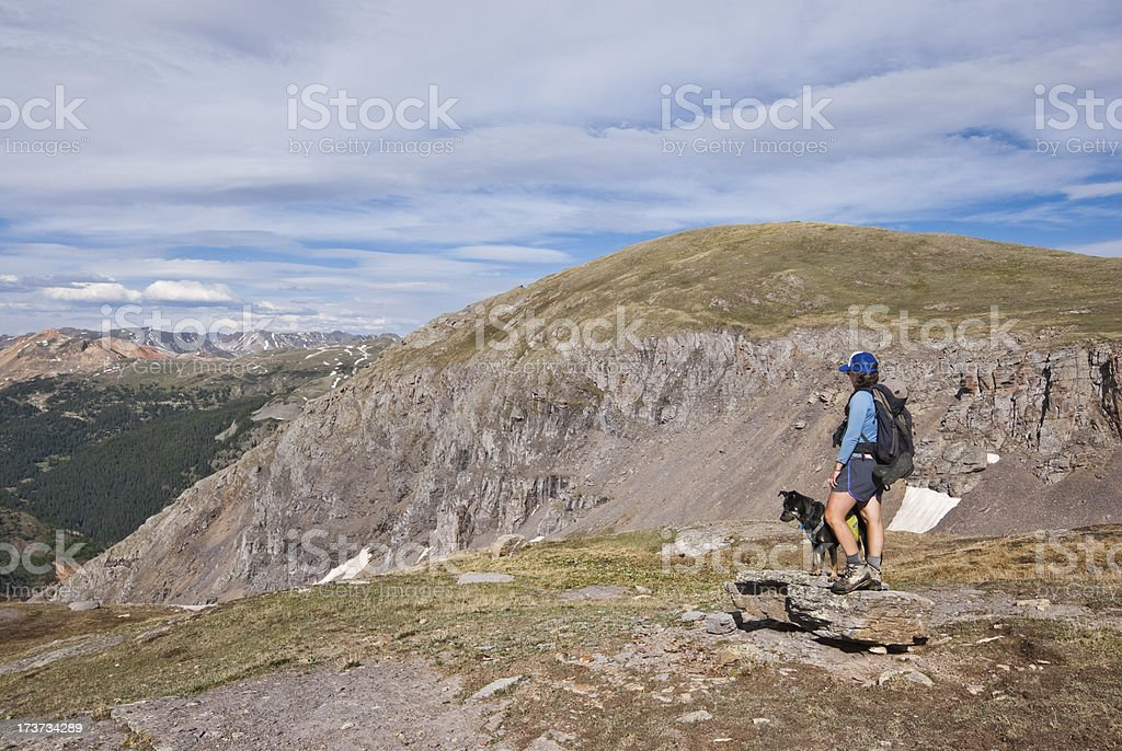 Hiker and Dog Looking at the View royalty-free stock photo